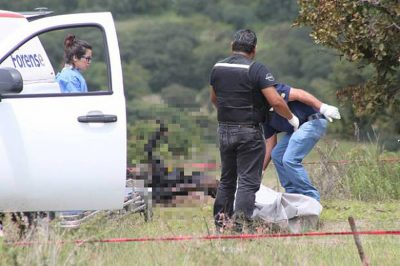 Investigators at work after Sunday night's executions.