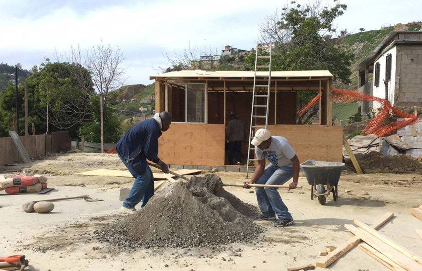 A small house goes up in Tijuana's 'Little Haiti.'