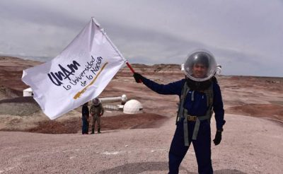 Mexican student on the 'Mars mission' waves the UNAM flag.