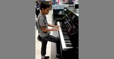Gael playing the piano at a Liverpool store on Sunday.