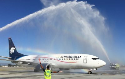 Inaugural flight gets a water cannon welcome in San Jose.