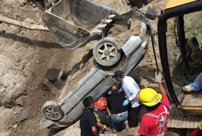 The vehicle being lifted from the sinkhole yesterday.