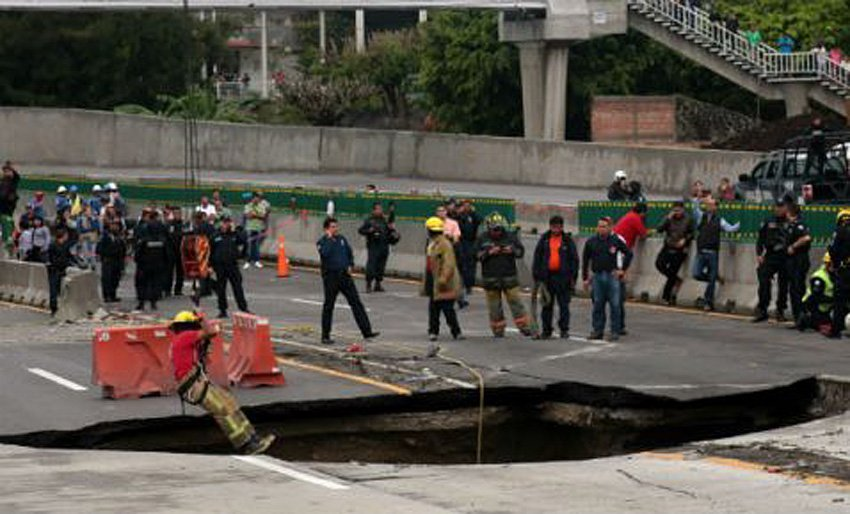 The sinkhole that trapped a vehicle this morning, killing two.