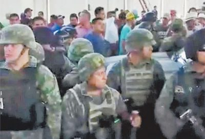 Some soldiers were surrounded yesterday by citizens.