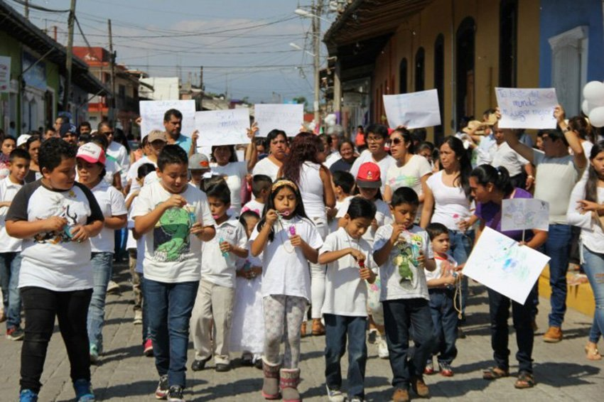 Residents march for justice Monday in Teocelo.
