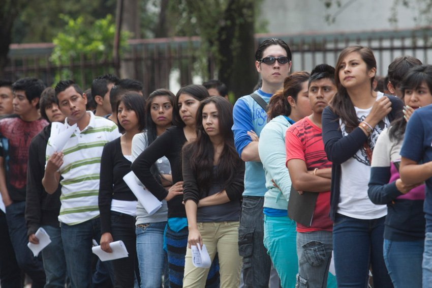 Students line up to enroll.