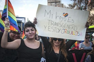 'My son is transgender and I'm proud,' reads the sign.