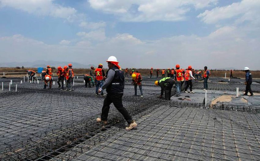 Workers lay rebar at new airport construction site.