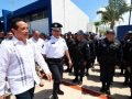 Governor González, left, inspects police officers.