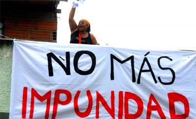 'No more impunity,' reads the sign.