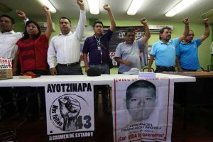 Oaxaca union leaders raise their fists in salute.