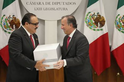 Meade, left, presents budget documents to Chamber of Deputies last Friday.