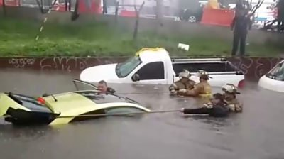 Floodwaters in the south of Mexico City yesterday.