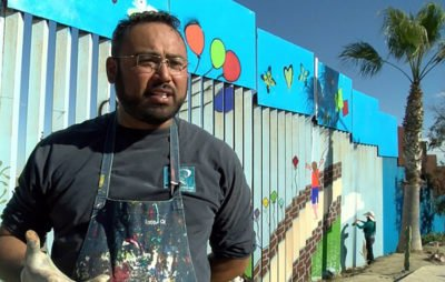 Artist Chiu and a portion of his mural.