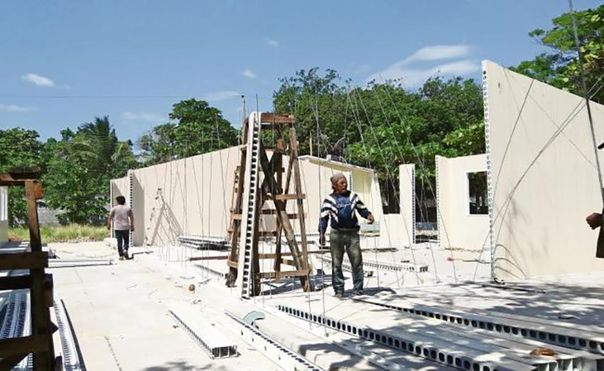 Workers at the site of new classrooms in Oaxaca.