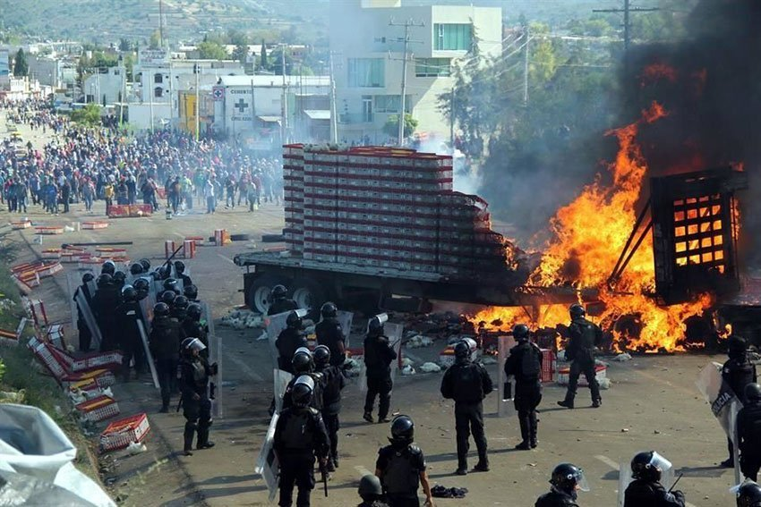 A tractor-trailer burns during last year's faceoff in Nochixtlán.
