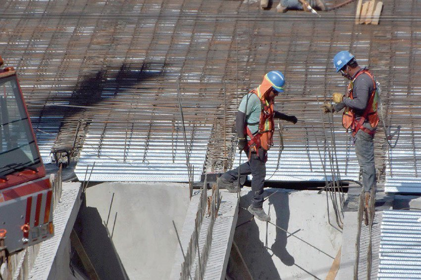 Workers at the site of repairs to the Paso Express.
