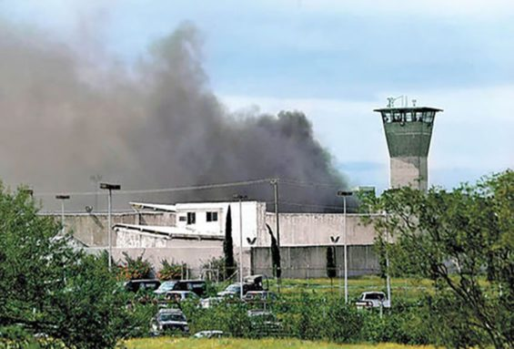 Smoke rises from the Cadereyta prison.