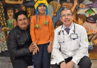 The Earthquake Boy, flanked by his father and doctor.