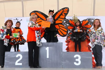 Students dress as butterflies for Tamaulipas competition.