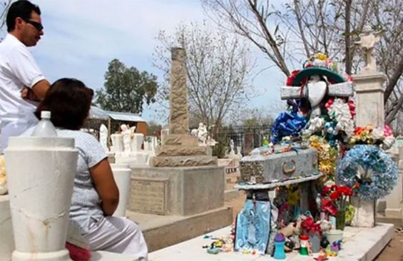 Visitors at the grave of Carlitos, a legend in Sonora.