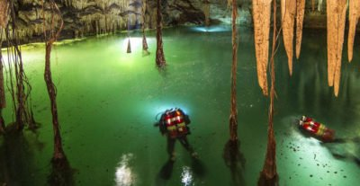 Divers with the Mayan Aquifer project explore a cenote.
