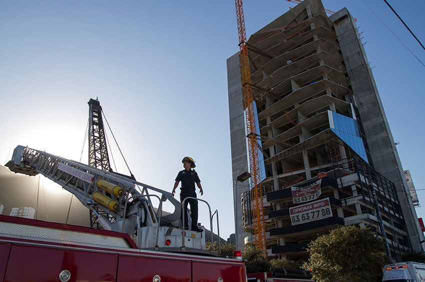 A firefighter at the construction site on Wednesday.