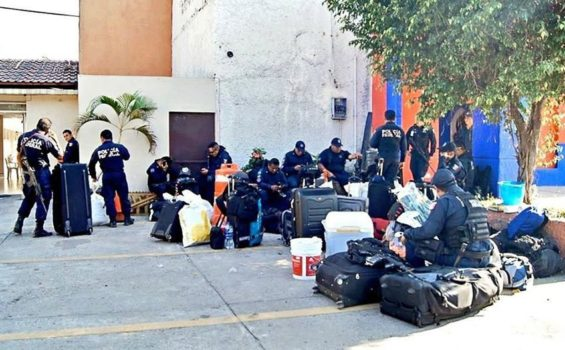 Evicted: Federal Police officers after their eviction from a Michoacán hotel.