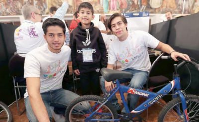 "A beneficiary and two of the students at this week's ""makeathon."""