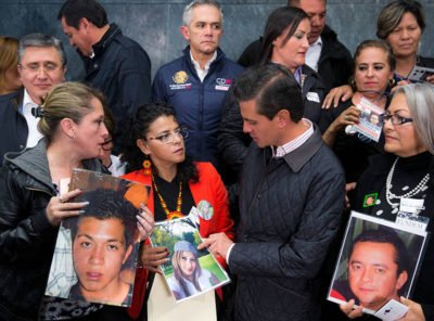 The president meets with relatives of missing persons yesterday.