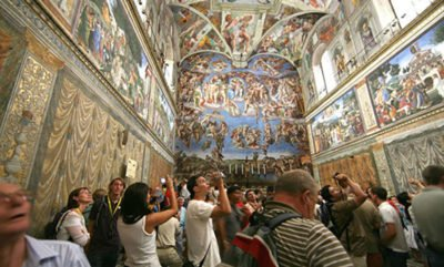 Visitors take in the Sistine Chapel — in Mérida, Yucatán.