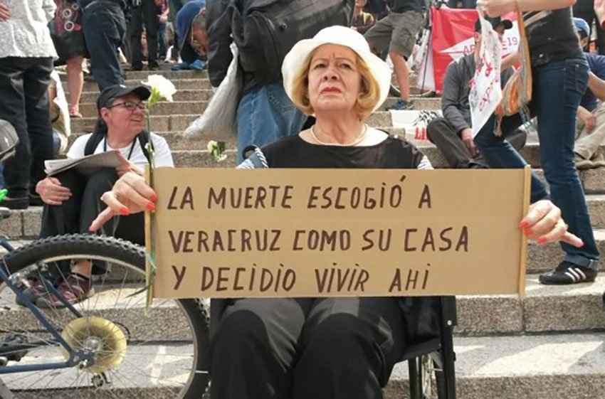A protest against violence earlier this year. The sign reads, 'Death chose Veracruz as its home and decided to live here.'