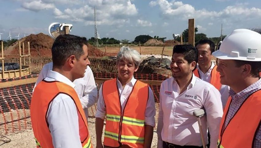 Murat, left, with company and government officials at the new wind farm.