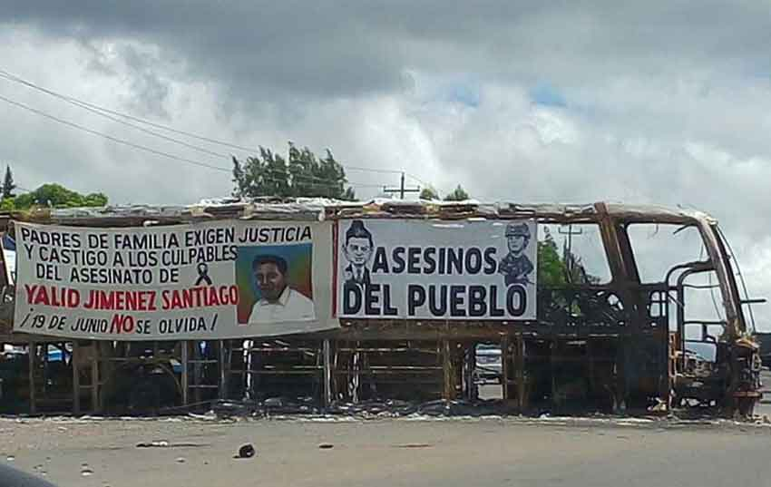 Burned-out bus at the scene of the confrontation in Nochixtlán, Oaxaca.