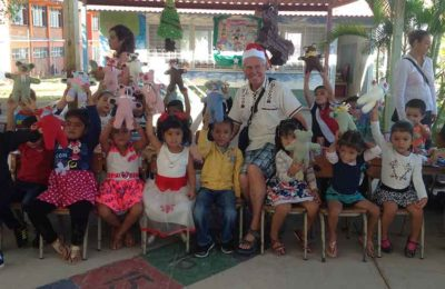 Father Arsenault with children and their teddy bears in Puerto Vallarta.