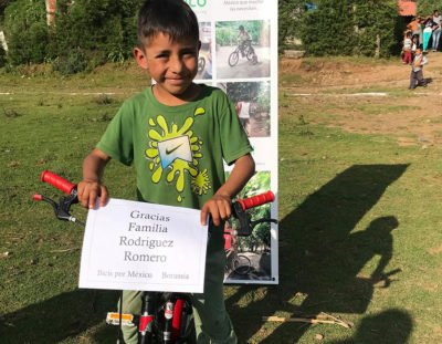 A happy recipient of a free bicycle.