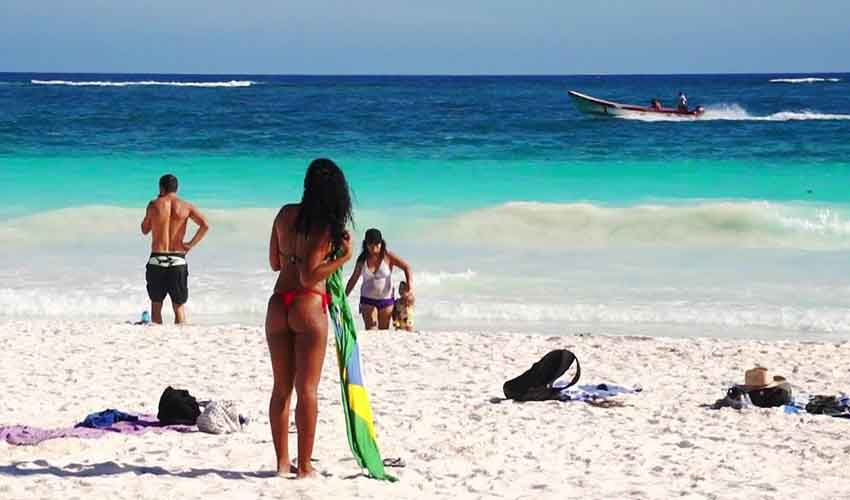 A beach in Tulum: some areas see little crime, says new travel alert.