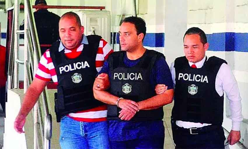 Borge is escorted from prison this morning by Panama police.