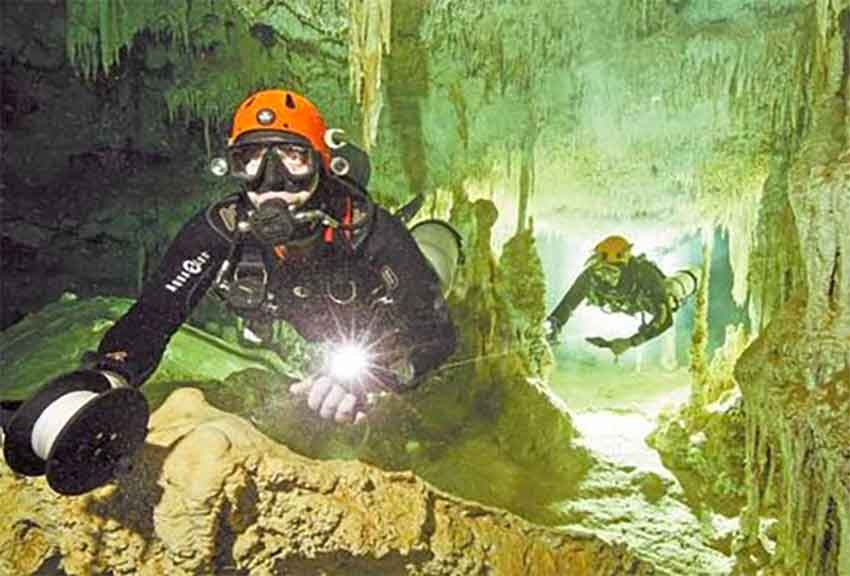 Divers in the underwater cave in Quintana Roo.