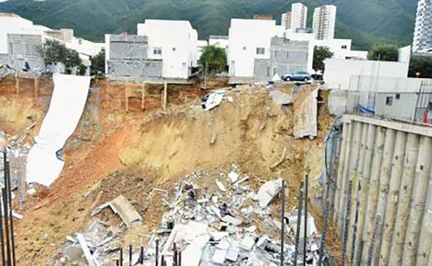 The construction site where adjacent homes fell into the excavation last year.