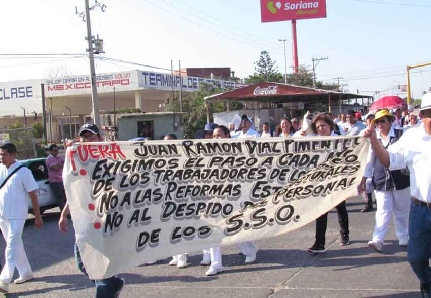Protesting health workers march in Oaxaca.