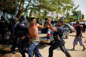 A community police officer is arrested in La Concepción, Guerrero, where 11 people were killed.