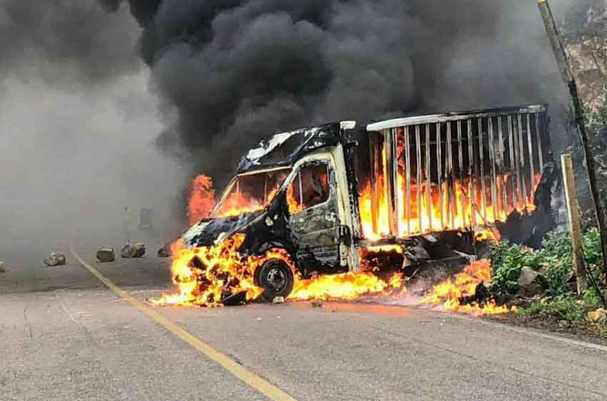 A truck burns during a violent clash in Oxchuc.