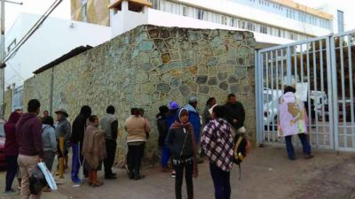 Patients line up outside a Oaxaca hospital affected by strike.