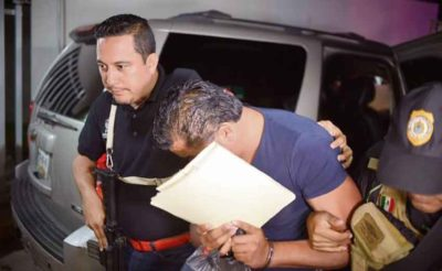 A former police chief is taken into custody in Veracruz.