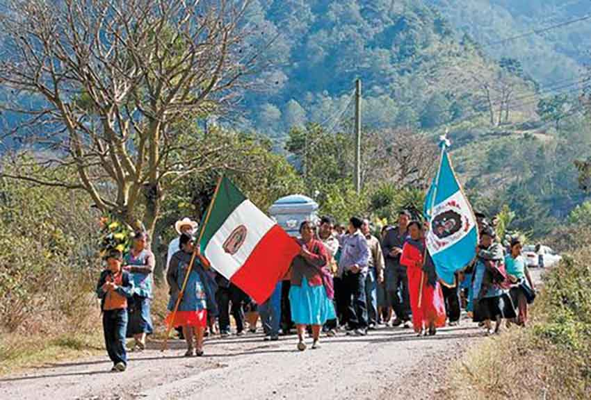 Funeral procession for artisans murdered in Guerrero.