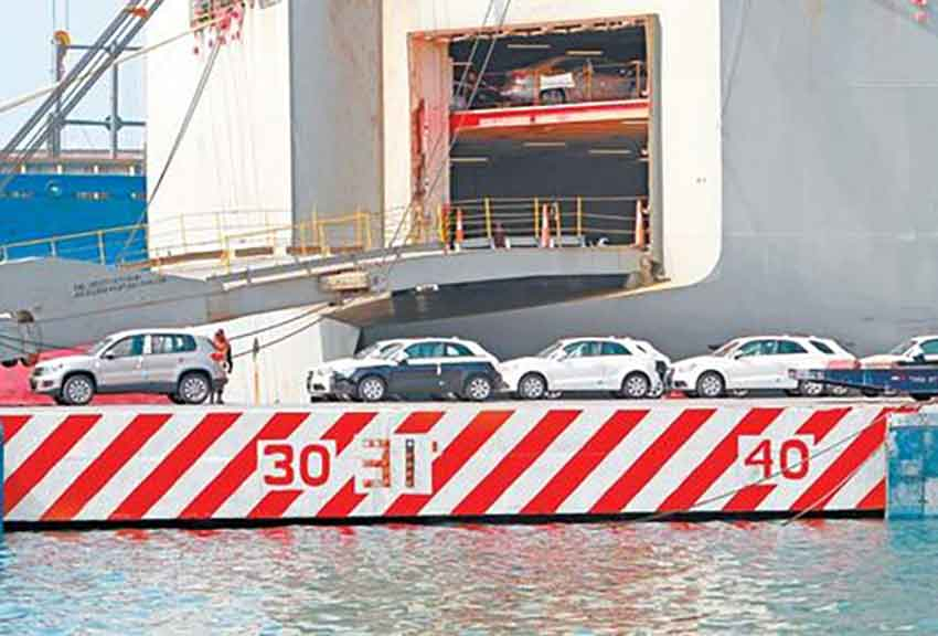 Mexican-assembled vehicles are loaded aboard ship for export.