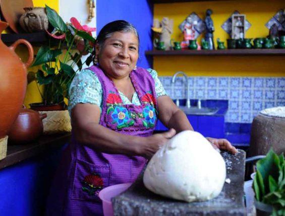 A Oaxaca cook with corn dough.
