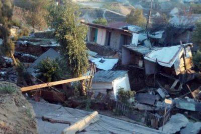 Tijuana houses damaged by Saturday's slide.