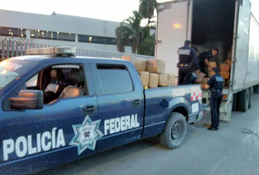 Marijuana is unloaded from a truck owned by the mayor.